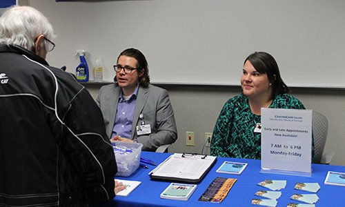 Evan Dyce, APRN, CNP, DNP, and Kristy Peterfeso, APRN, CNP, enjoy taking part in a local health fair.