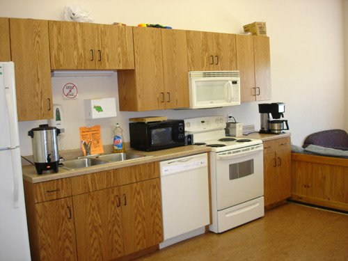 Resident kitchen and dining area where women can make a snack or socialize