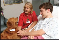 Animal Assisted Therapist with patient
