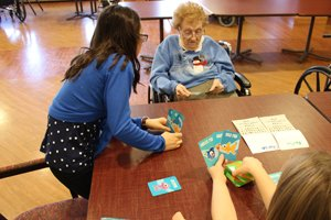 Twice a month, the 4th graders are paired with a resident, and they spend time together reading books, doing arts and crafts, and sharing stories. The program has made a tremendous impact on the residents and the students.