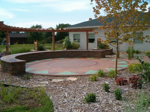 The patio of stamped concrete in the shape of a sunflower offers space for large and small group therapy.