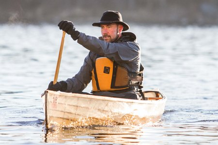 Alexander J. Schad, MD, paddling to work on the Mississippi River. Dr. Schad started going on Boundary Waters trips when he was 7 and today enjoys teaching his kids how to paddle.