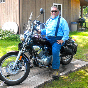Alec rewarded himself with a new motorcycle once he hit the 50-pound weight loss mark in Summer 2018.