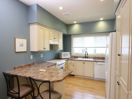 This cozy kitchen area is handicap accessible.